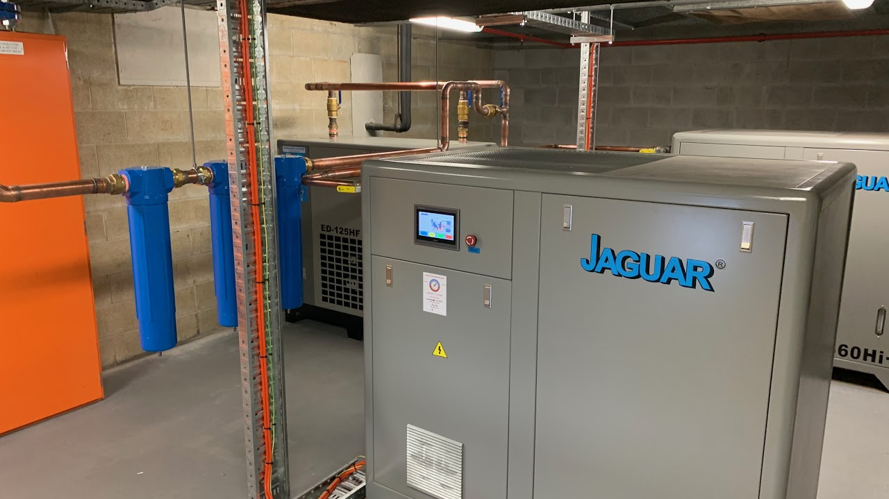 Compressors connected and providing clean, dry, filtered air-Floors painted and Compressors Commissioned